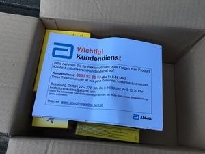 offenes Starterpaket mit Hinweis Kundendienst